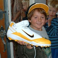 Teddy Huttenhower shows off his Ben Roethlisberger shoe to his 1st  and 2nd grade classmates on Monday.  Photo courtesy of Rich  Huttenhower.  Please do not use or copy without Mr. Huttenhower's  permission.